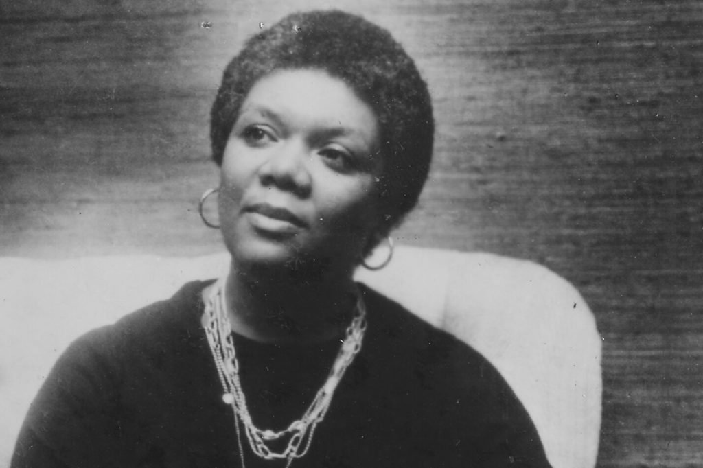 Poet Lucille Clifton looks off to the side while being photographed.