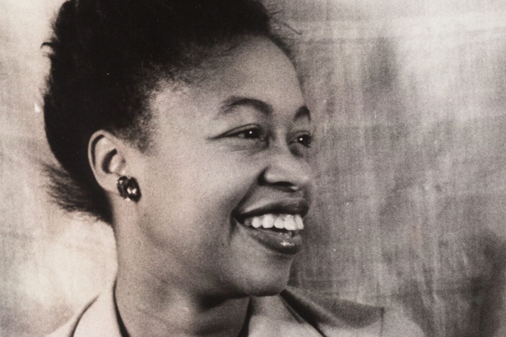 Poet Margaret Walker laughs and looks to the side.