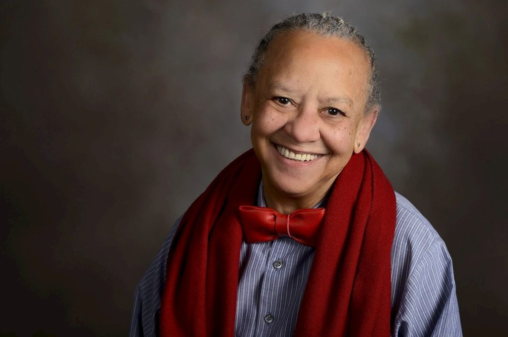 A photo of poet Nikki Giovanni in a red scarf.