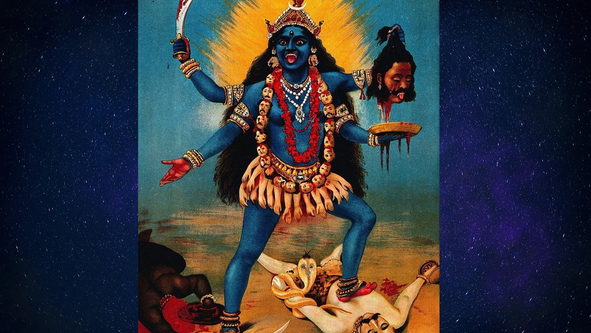 The picture of four armed Goddess Kali, standing atop Shiva holding the decapitated head of a man.