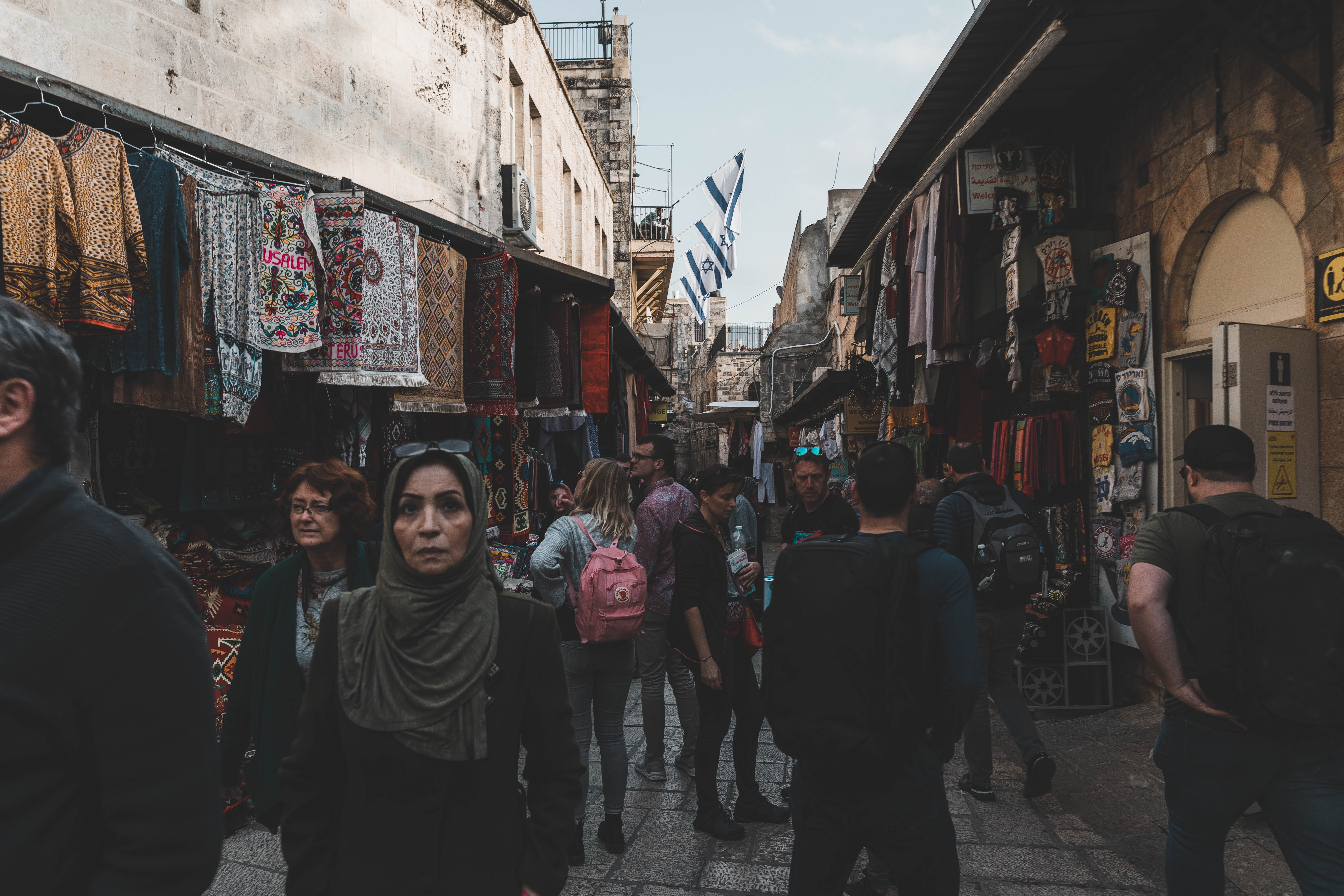 An image of pedestrians at a street market in Israel/Palestine.