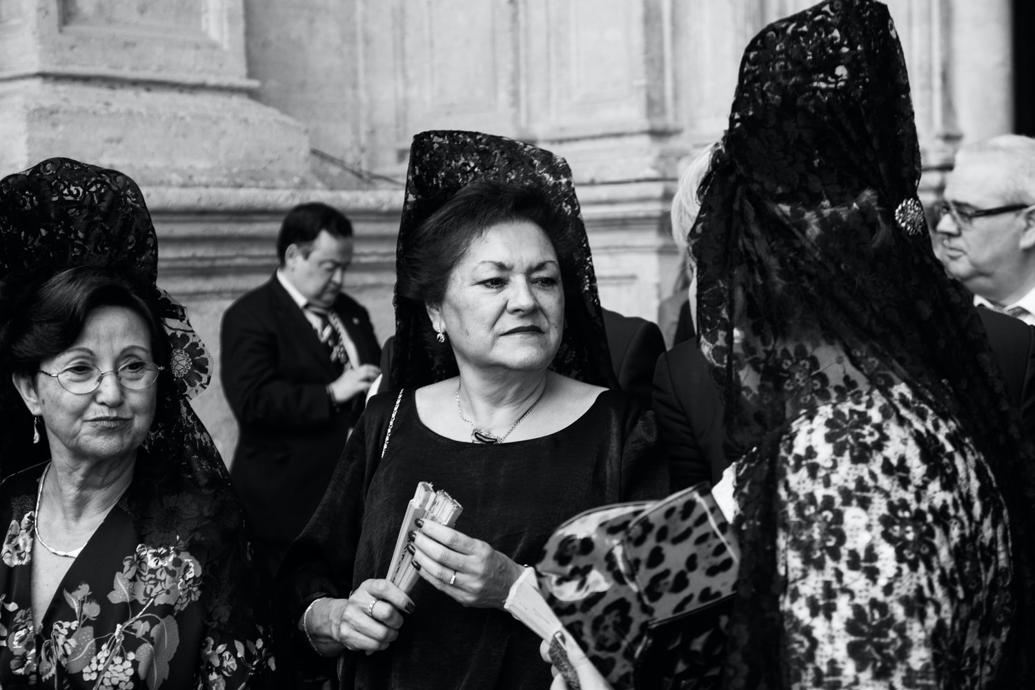 women in Spain wearing the traditional mantilla.