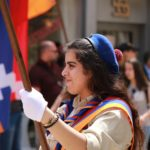 A young Girl Scout holding an Armenian flag
