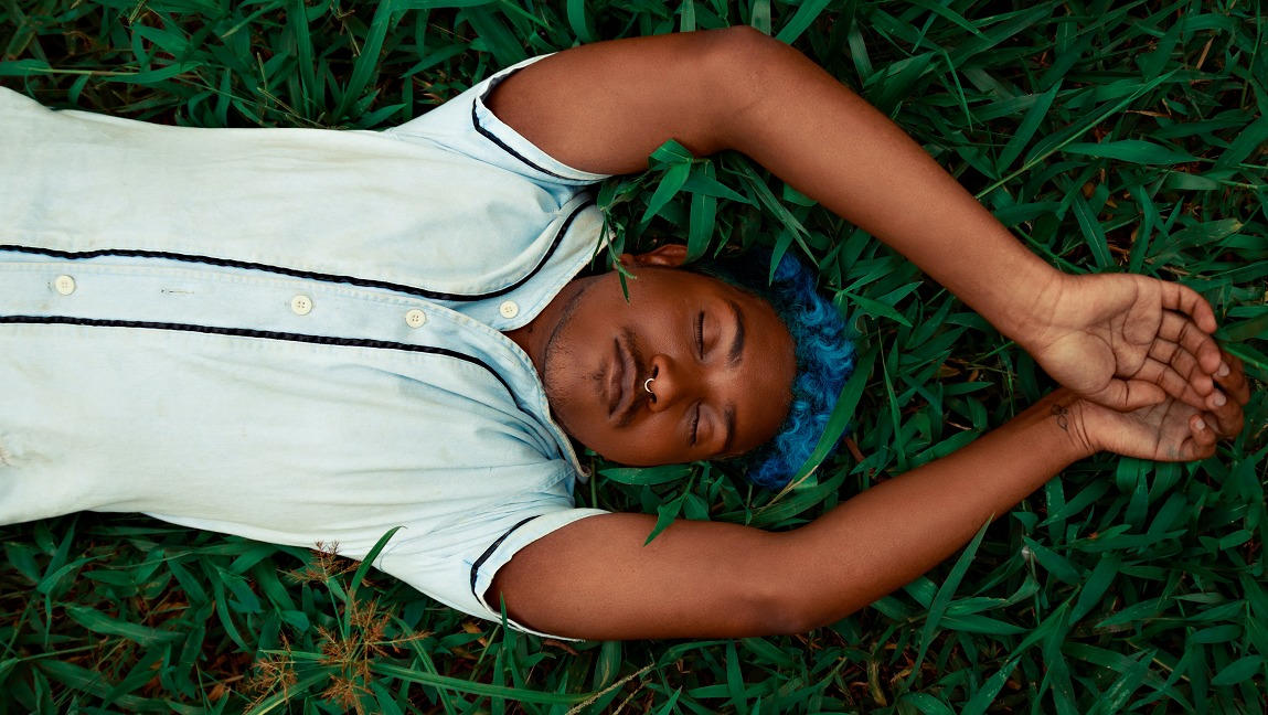 A person sleeping in grass. Sleep disorders are still a mystery.