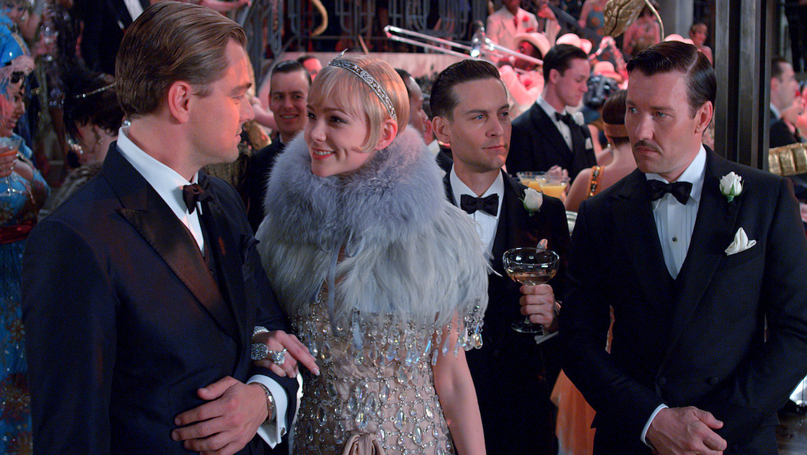 "[Image Description: Leonardo Dicaprio As Jay Gatsby, Carey Mulligan As Daisy Buchanan, Tobey Maguire As Nick Carraway And Joel Edgerton As Tom Buchanan In The ""The Great Gatsby"".] Via The Atlantic"