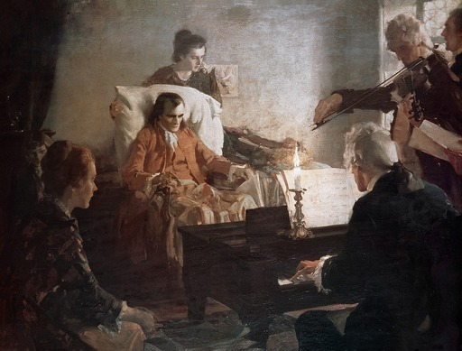Painting of The Death of Mozart by Charles E. Chambers. A sickly man sits in front of a pianist, surrounded by two women and a violinist