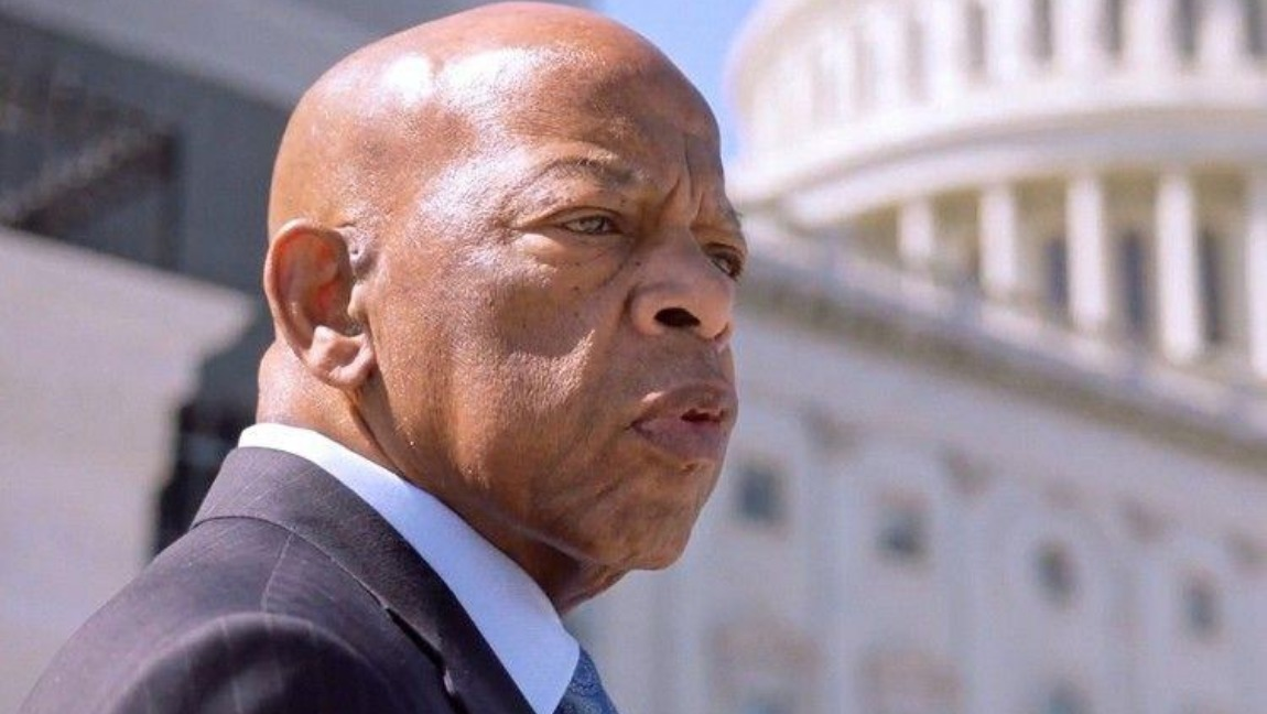 John Lewis stands in front of Capitol Hill.