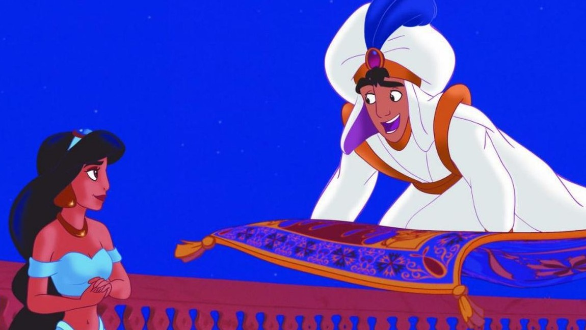 A still from Aladdin: a woman and a man on a flying carpet look at each other. Via Disney on Slate.