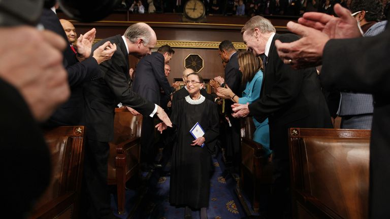 [Image Description: The court clapping for RBG] Via SkyNews.