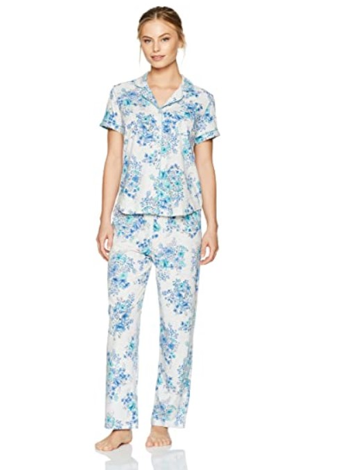 [Image description: A women modelling blue and white floral pajamas.] via Amazon