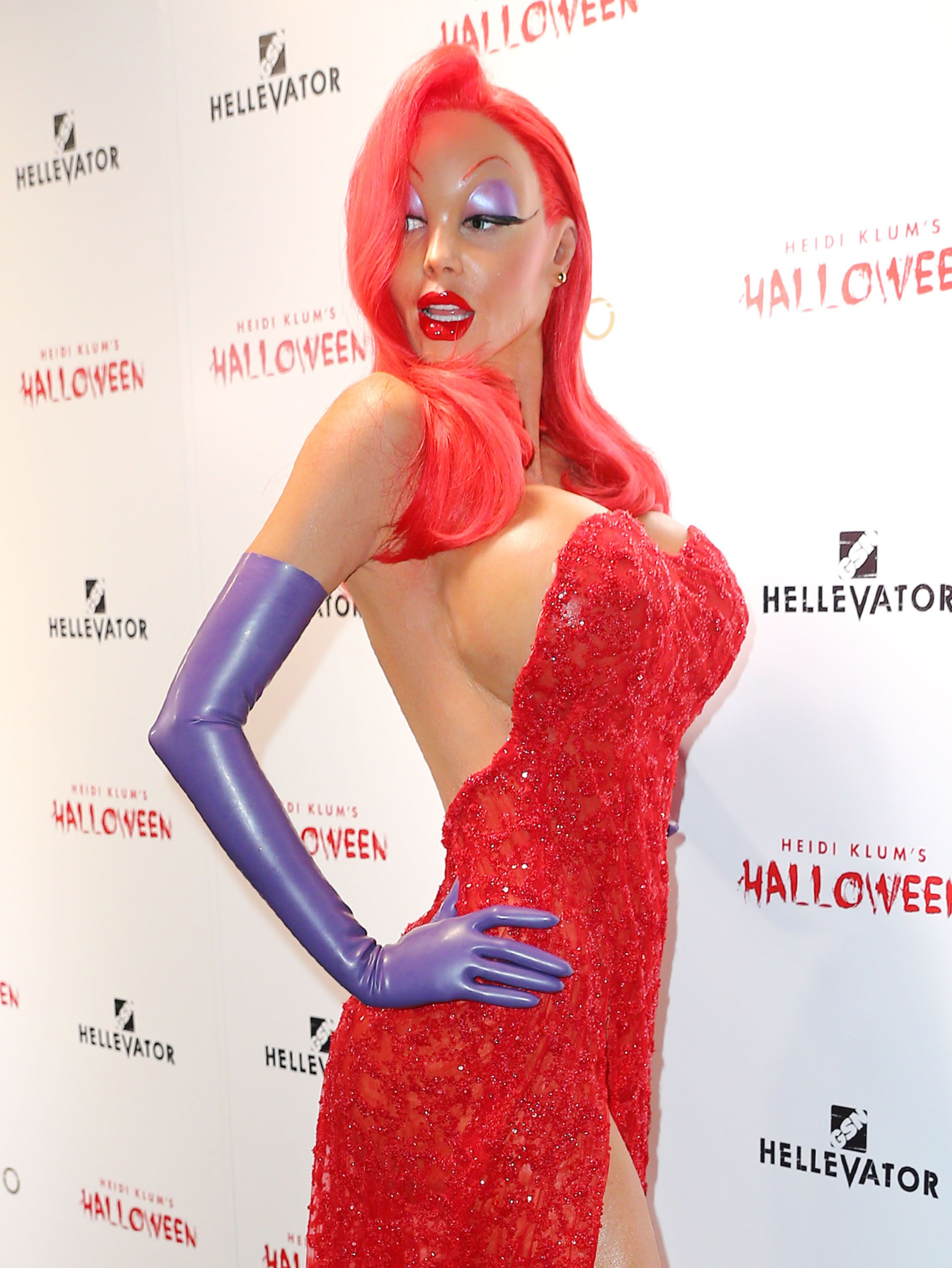 Heidi Klum as Jessica Rabbit, with bright red hair, a voluptuous red dress and prosthetic makeup.