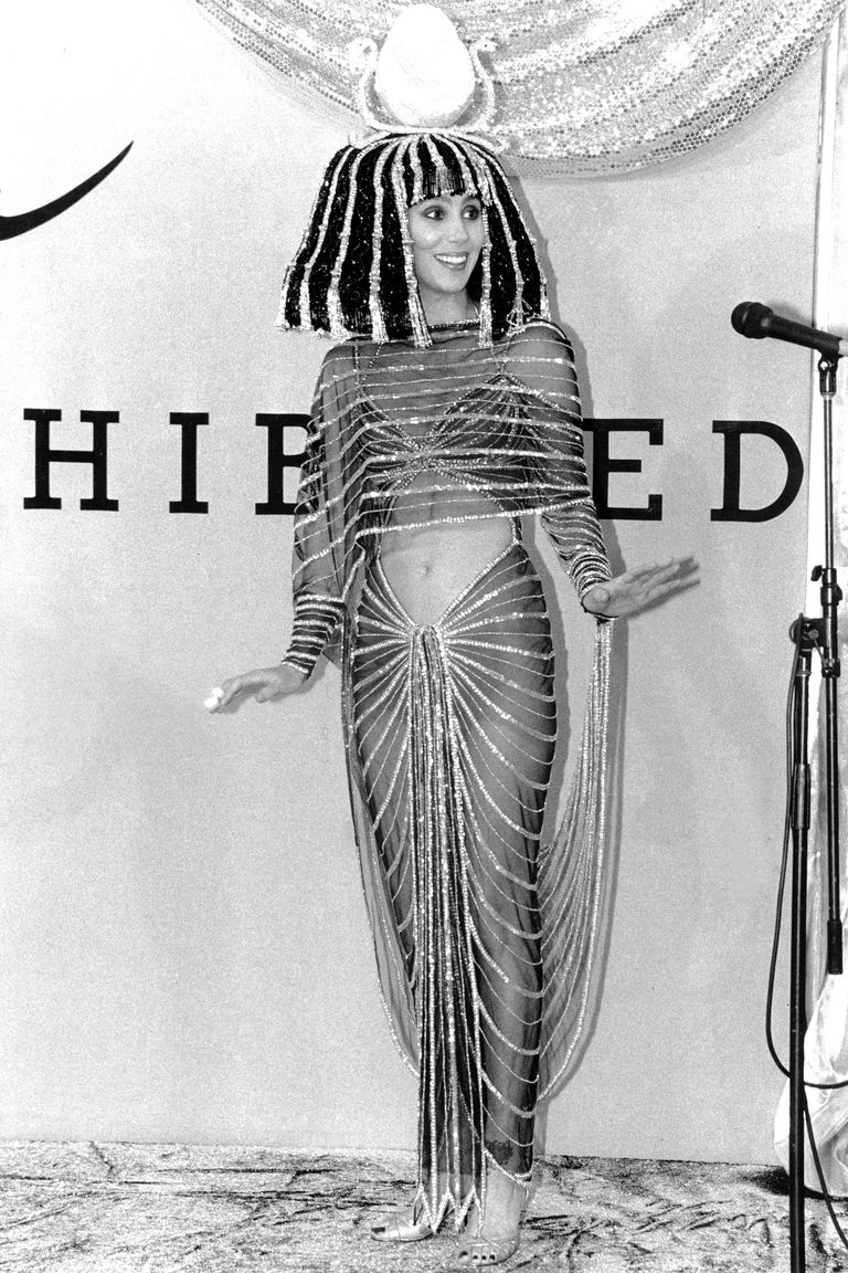 Cher as Cleopatra was a vision. She wore the elaborate glittering headdress, the sequinned harem pants and matching crop top.
