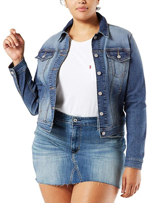 [Image description: a women modelling a waist-length denim jacket.] via Amazon