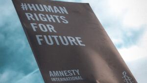 """[Board held saying """"#HUMAN RIGHTS FOR FUTURE""""]"""