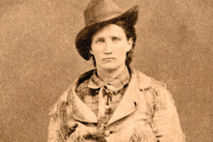 Calamity Jane wearing a cowboy hat and a large jacket