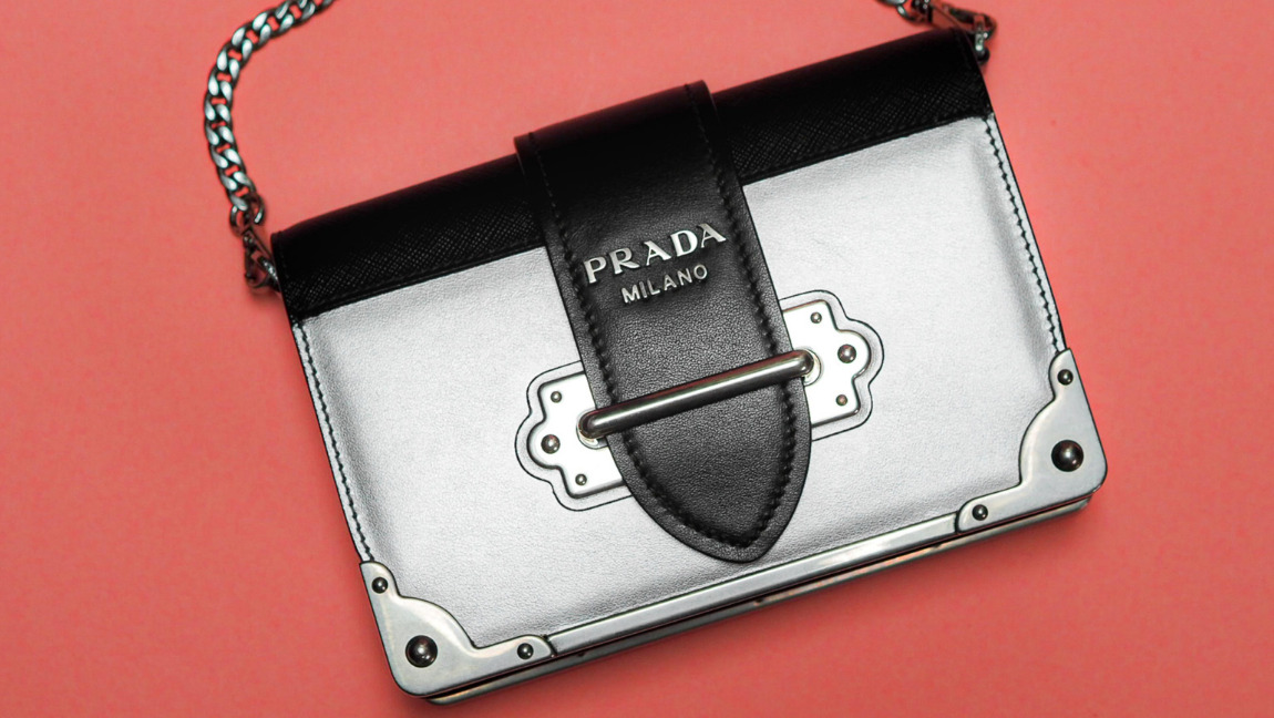 A silver Prada bag with a chain handle.