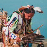 [Image Description: Lakota Native American Man at Pow Wow]