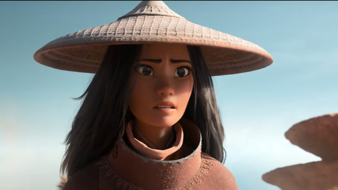 [Image Description: Screenshot of Disney's trailer for Raya and the Last Dragon, with a girl in the sunlight wearing a hat.] Via Disney