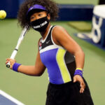 Naomi Osaka wearing a 'Breonna Taylor' mask while playing