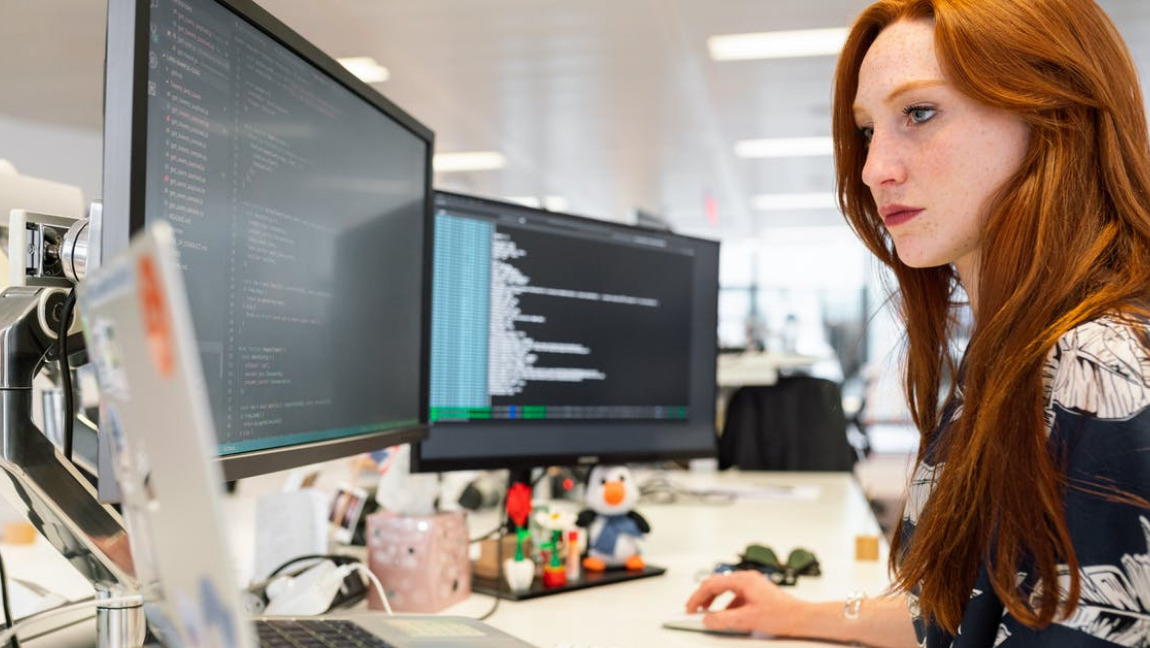 [Image Description: woman coding on computer] via Pexels