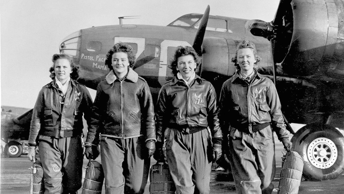 Members of WASP (from left to right), Frances Green, Margaret (Peg) Kirchner, Ann Waldner and Blanche Osborn leave their ship, Pistol Packin' Mama, a B-17 Flying Fortress, at the engine school at Lockbourne AAF, Ohio.