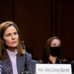 [Image Description: An photo of supreme court nominee Amy Coney Barrett at her hearing] Via Getty Images