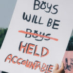 "Sign that reads ""boys will be held accountable""."