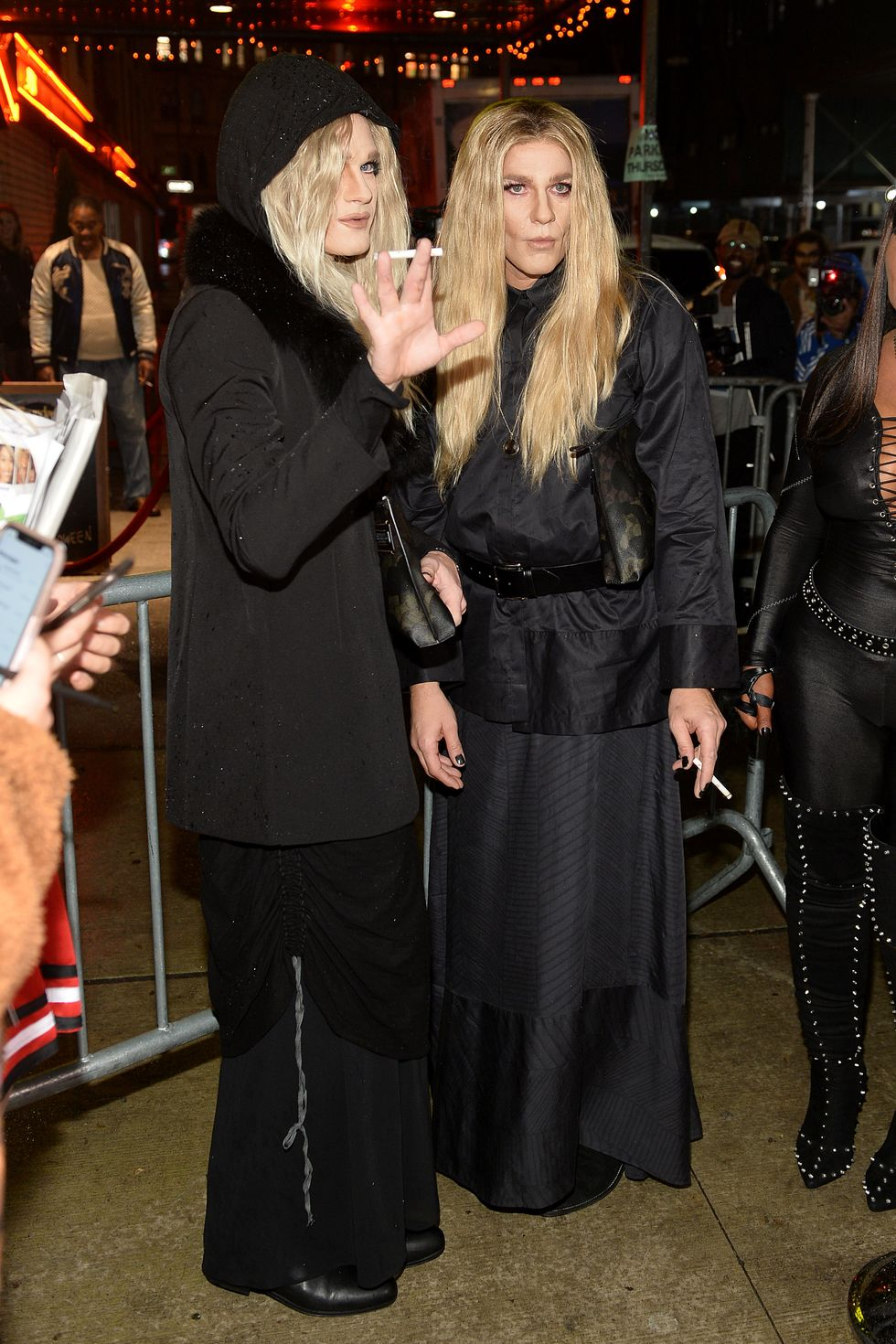 Neil Patrick Harris and David Burtka dressed up as the Olsen twins, with all-black outfits, long blond wigs, pouty makeup and cigarettes in hand.