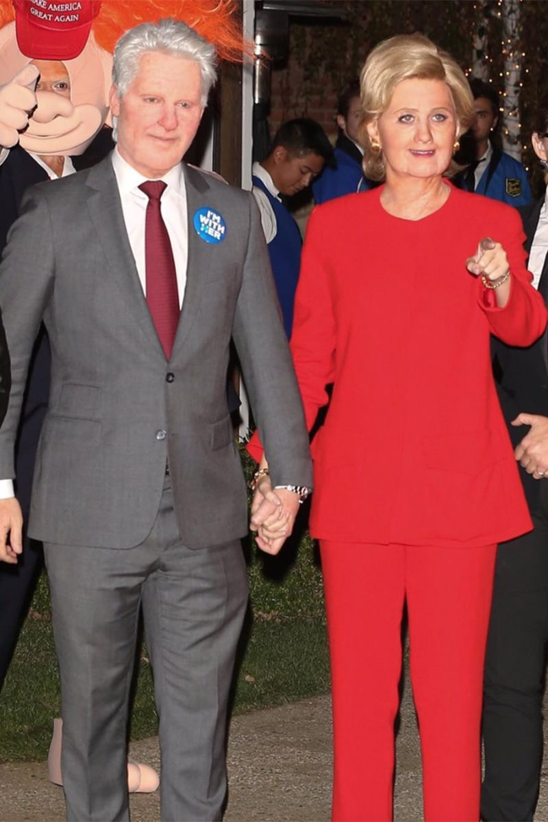Orlando Bloom and Katy Perry dressed up Bill and Hillary Clinton. The prosthetic makeup completely transformed their faces and Orlando is wearing a grey suit, while Katy is wearing Hillary's iconic red suit with short blond hair.
