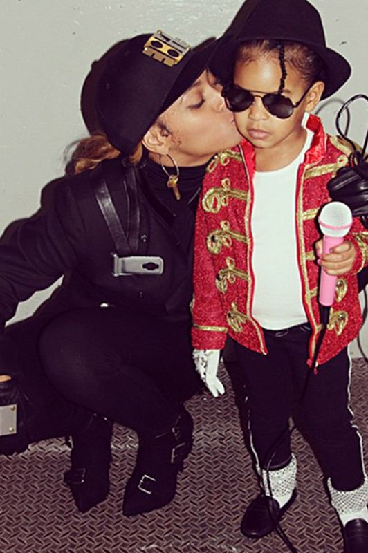 Beyoncé and Blue Ivy dressed up Janet and Michael Jackson in their most iconic outfits. Beyonce is in all black with a baseball cap as she kisses Blue Ivy, who is dressed in MJ's red jacket, black fedora, silver socks and a microphone in hand.