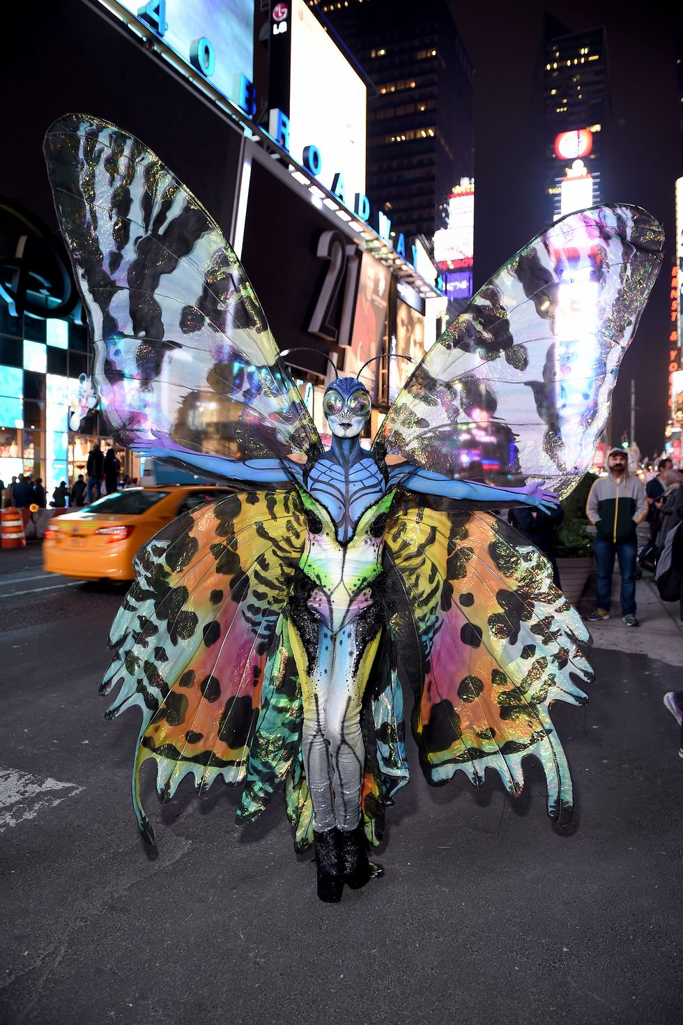 Heidi Klum as a multicolored butterfly was a work of art. She's wear prosthetic makeup, with bug eyes, giant translucent wings and a colorful bodysuit.