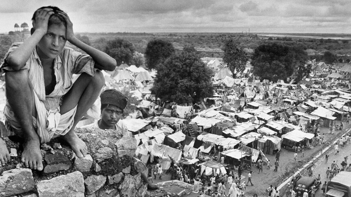 [Image Description: A boy in a refugee camp in Delhi during the Partition in 1947.] via Margaret Bourke-White, Life Magazine