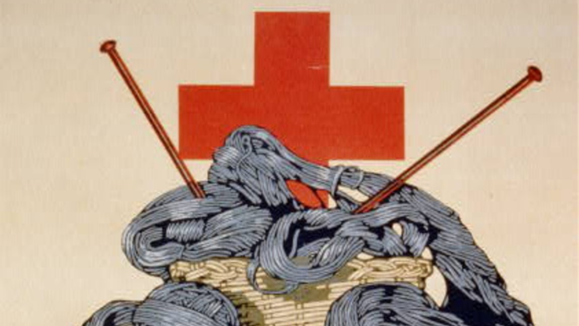 "A poster from 1918 showing a knitting basket with grey yarn and two knitting needles sticking out of it. Behind is the American Red Cross logo, and beneath the basket is a sign that says, ""Our Boys Need SOXS Knit Your Bit."""