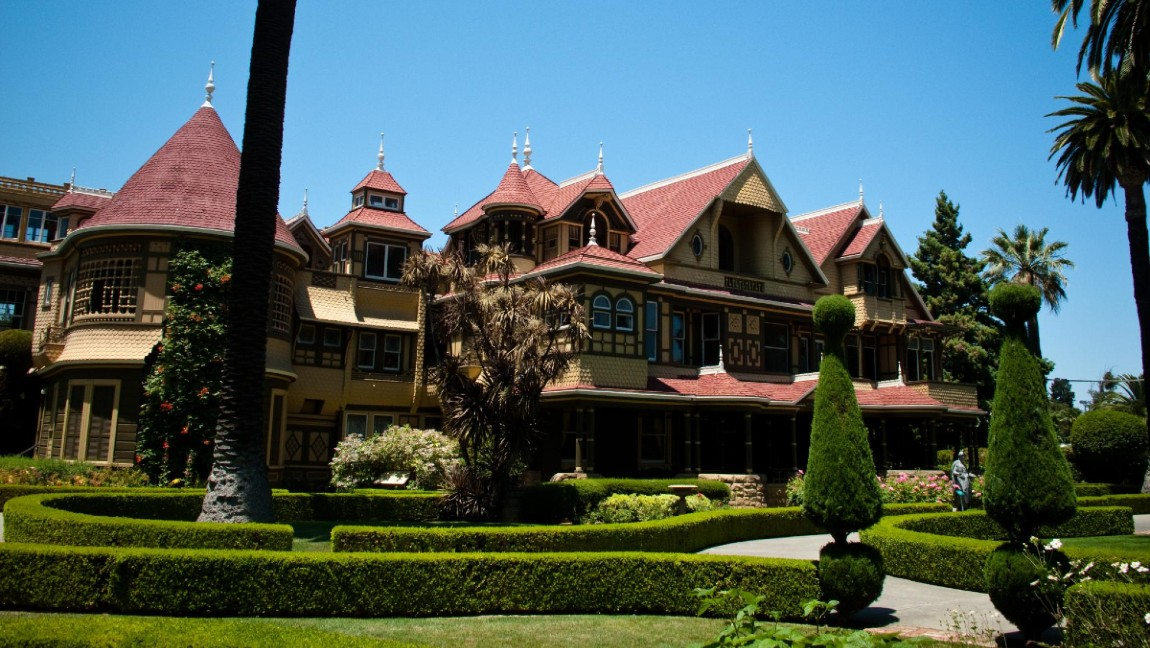 The Winchester Mansion is a Queen Anne/Victorian styled mansion, with yellow walls and red shingles, located in San Jose, California.