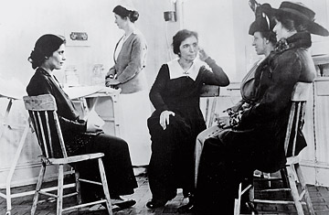 Margaret Sanger with other women at the first birth control clinic.