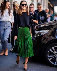 Olivia Palermo in a green pleated skirt