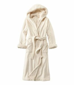 A cream robe with a hoodie