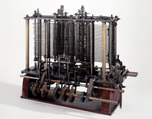 [Image description: part of the Analytical Engine made of wood and metal.] via Wikimedia Commons