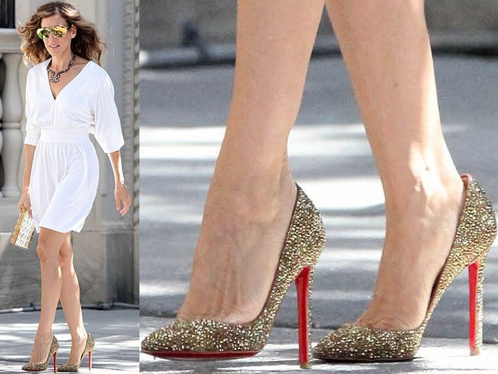 Carrie Bradshaw walking outside wearing a white dress, sunglasses and gold glittery heels