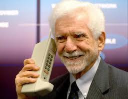 Martin Cooper with his invention - the first cell phone.