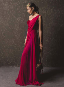 A woman wearing a deep red draped concept sari