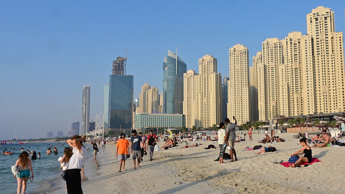 Citizens and residents enjoying a day at the beach in Dubai.