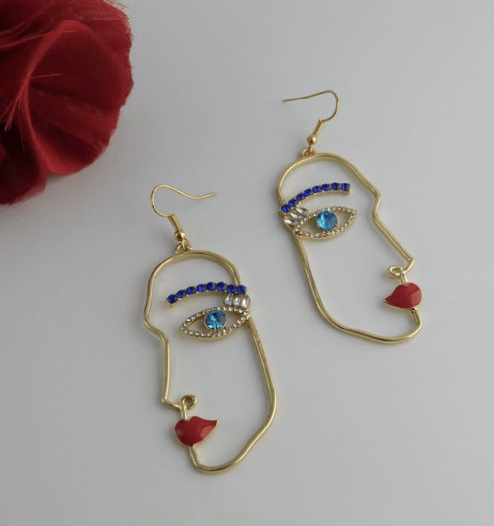 [Image description: Bejeweled earrings on a white background.] Via Etsy