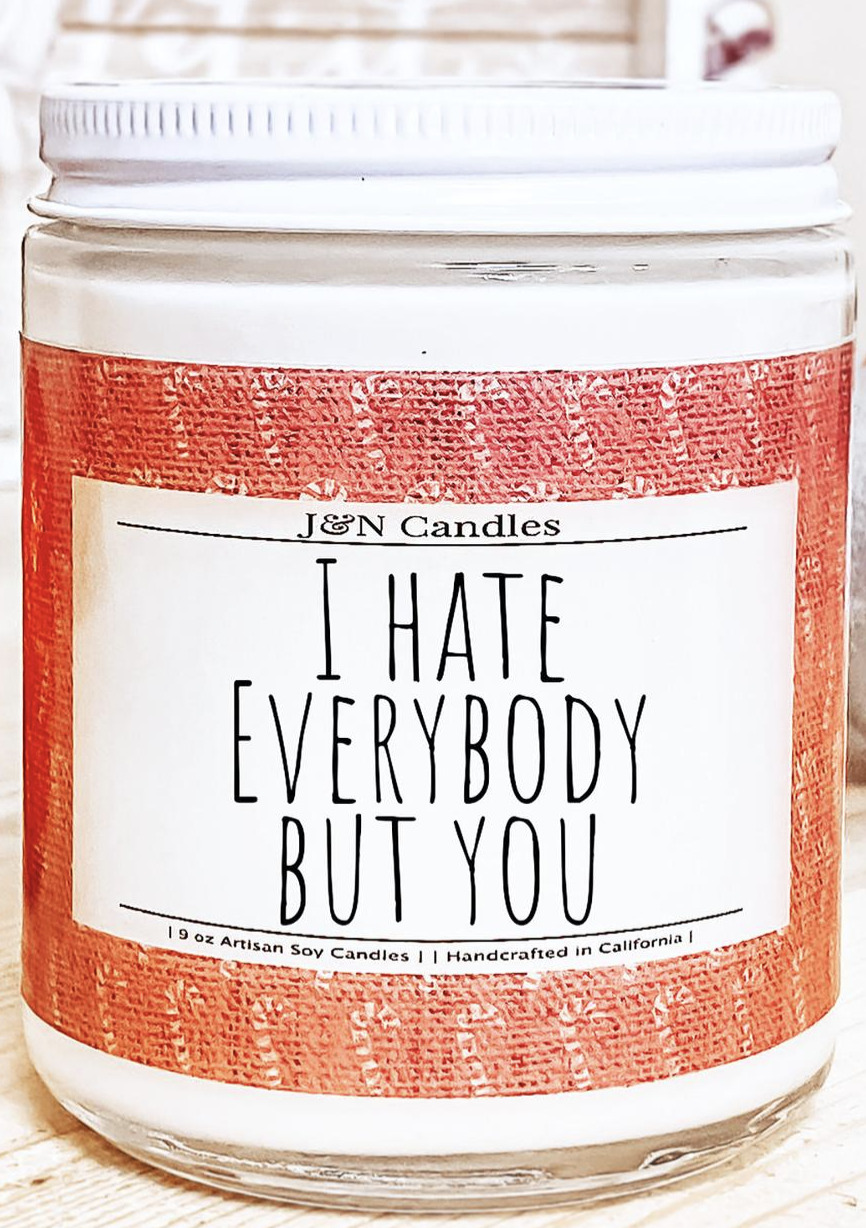 [Image description: A holiday-scented candle with a cute message on it.] Via Etsy