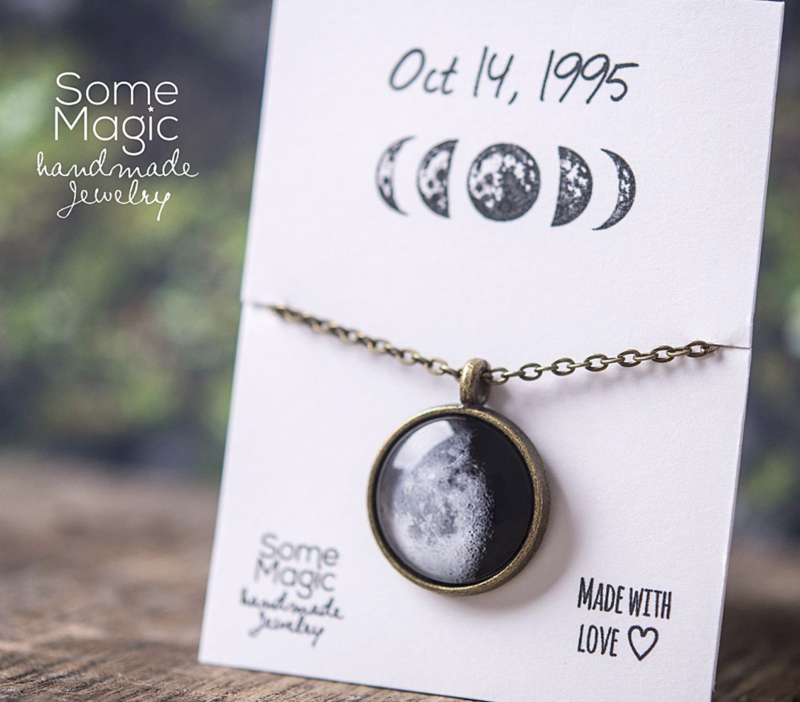 [Image description: A customized moon phase necklace created for a birthday.] Via Etsy