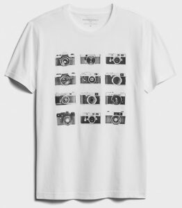 A graphic t-shirt with pictures of cameras on it.