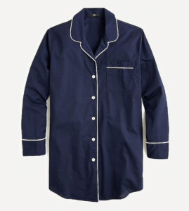 A dark blue long nightshirt with white trim and buttons.