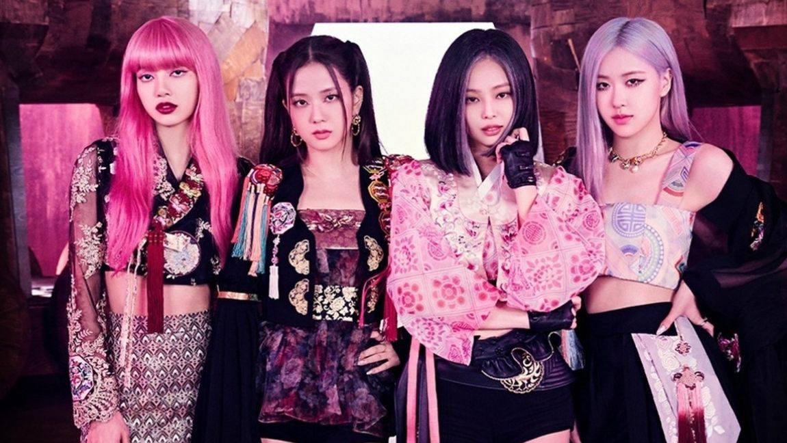 [Image description: Blackpink members Lisa, Jisoo, Jennie and Rosé dressed in their How You Like That outfits] via YG Entertainment