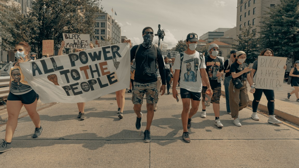 [Image description: People march at a Black Lives Matter protest ] Via Unsplash