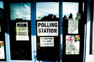 A polling station with voting related posters on the door